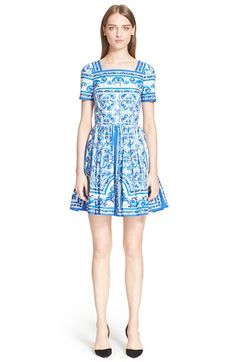 Free shipping and returns on Dolce&Gabbana Tile Print Cotton Poplin Fit & Flare Dress at Nordstrom.com. Inspired by traditional Italian Maiolica pottery, the intricate tile-motif of this cotton dress evokes the rich culture and history of the Mediterranean. A fitted square-neck bodice pairs with a voluminous pleated skirt to beautifully showcase the style's saturated color palette and superb construction.