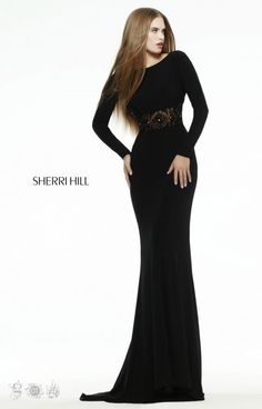 Sherri Hill 32121 is a sleek and sexy long sleeve gown made of the the fitted jersey knit fabric. With a sheer and beaded waistband at the natural waist, this gown will hug your figure while flattering all of your curves! Sherri Hill 32121 is the perfect dress for your big night out!