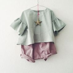 baby clothes in mint and pink