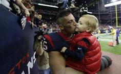 Houston Texans inside linebacker Brian Cushing (56) pulls his son, Cayden, 2, from the stands after an NFL football game against the Jacksonville Jaguars Sunday, Dec. 28, 2014, in Houston. The Texans won 23-17.(AP Photo/David J. Phillip)
