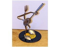 The Guitar Player - made from silverware and mounted on a 45 record. Welded Art, 45 Records, Guitar Art, Welding, Metal Art, Create Yourself, Sculpture, Etsy, Soldering