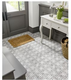 We love these Mr. Jones ceramic square floor tiles featuring geometric patterns by British Ceramic for Laura Ashley #ceramicfloortiles #tastytiles #traditionalstyletiles #geometrictiles #greytiles #patternedtiles