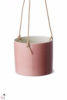 This handmade hanging flowerpot by Anne Black is made from fine porcelain and comes in a wide array of beautiful colours.