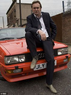 "Gene Hunt (Philip Glenister) of ""Life on Mars"" and ""Ashes to Ashes"".  Fire up the Quattro."