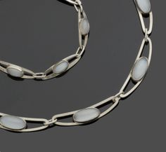 Aksel Holmsen: A Norwegian enamel bracelet and brooch, a Swedish gem set necklace and bracelet suite, and a brooch by Trifari (5)