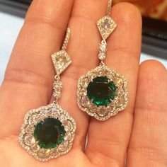 Emerald and diamond earrings from @omiprive on the hand of @the_diamonds_girl !