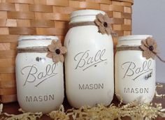Painted Mason jars. Set of 3 Annie Sloan chalk painted mason jars. Embellished with burlap button flowers. - pinned by pin4etsy.com