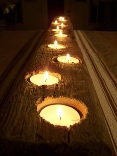 Drill holes in wood, place tea lights. love this!! Now this piece of wood we found last year on the beach..waterlogged…