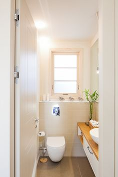 Guest toilet Room - free standing sink, big mirrow, brick wall. © designed by TAPOOLY - Architecture & Design.