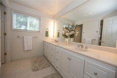 Traditional Full Bathroom with Raised panel, limestone tile floors, Double sink…