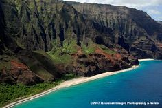 Kauai's dramatic Napali coast, a dozen miles of cliffs, valleys, and secluded beaches.... most beautiful place I have ever been.