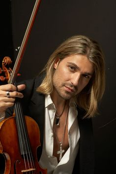 David Garret - I don't usually like long hair on guys, I'd make an exception for him!! Plus he's amazing with his hands!! Hey oh!!