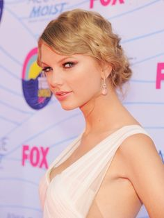 17 Celebrities With Curly Hair That Rocks   Taylor Swift - Soft waves give any pulled back hairstyle a glint of Hollywood glamour.