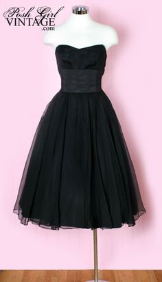 50's black dress.  Wear with polka dot shoes.