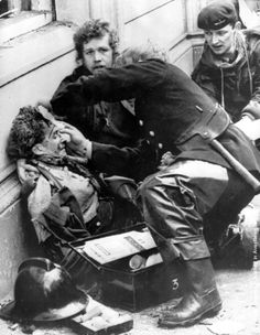 Firemen tend to a wounded victim of an Irish Republican Army car bomb explosion in Donegal Street, Belfast. The blast killed 6 people and injured 146 Northern Ireland Troubles, Irish Republican Army, Orange Order, Emotion, British Army, Belfast, Vintage Photographs, Stock Pictures, Armed Forces
