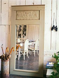 DIY - old door into beautiful mirror.  Save the money and construct a custom frame by building your own around a mirrored closet door. Incorporate a piece of paintable textured wallcovering to the inset panel above the mirror. Try adding decorative trim or molding for an extra design motif.