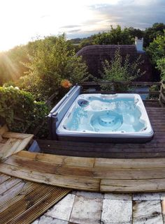 Sit back, relax, and enjoy the view in a Hot Spring Relay #spa. This Happy Hot Tubs installation has a beautiful view of the forrest.