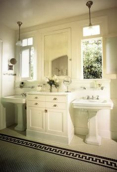 Clic White Bathroom By Kevin Oreck With Two Pedestal Sinks Under Windows Flanked Built In Cabinets And A Tile Floor Black Border