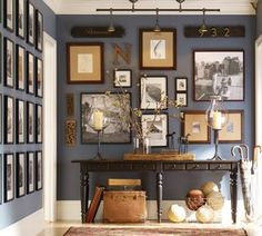 Pottery Barn, of course... LOVE this gallery wall... all the way to the ceiling.  Smart.