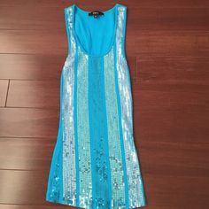 Express sequin tank Blue sequin tank from express, size XS, easy to wear, looks cute with dark skinny jeans. Express Tops Tank Tops
