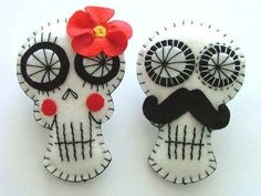 Day of the Dead theme? We love these matching skull boutonniere pins. He can wear one on his lapel, and you can attach the other to your bouquet. @myweddingdotcom