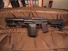 Tippmann (custom) This is too cool to be a Tippman paintball gun! Airsoft Field, Paintball Gear, Airsoft Guns, Weapons Guns, Guns And Ammo, Air Cannon, Concept Weapons, Cool Guns, Assault Rifle