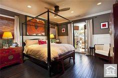 Dark wood floors. Master bedroom