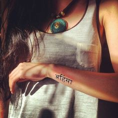 Ahimsa tattoo// totally want and i like the placement