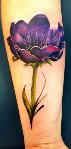 Anemone flower tattoo on the back of my forearm