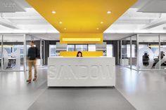 Corporate white reception desk + yellow striped ceiling