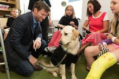 Dale Jr. at Nationwide Children's Hospital with therapy dog Beck