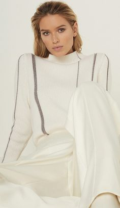It's all in the detail with the Naomi top in white. Finished with a high neckline and metallic-striped design, it's an effortless way to elevate your daytime look. Find the perfect pairing in our new arrivals. Chundky Winter Knits. Christmas White and Silver Jumper. Winter Knitwear. Ladies Knitwear. #Fashionista. Fashion Blogger. Blogger Fashion. #fashion #fashionista #affiliatelink #ootd #winterfashion