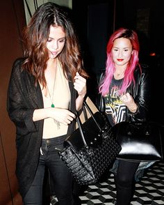 Getting dinner with Selena Gomez following the Biebs' arrest, Demi Lovato showed off her newly-dyed pink hair.