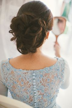 Bride in powder blue wedding gown and low tousled chignon bridal hairstyle // Idzmil and Shireen's Wedding at Villa Ombak Biru, Bali