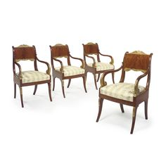 A set of Four Russian Neoclassical carved Giltwood Mahogany Armchairs, circa 1825.