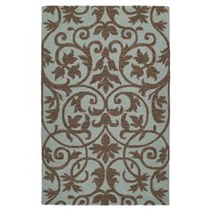 Anchor your living room seating group or define space in the den with this artfully hand-tufted wool rug, featuring a scrolling motif for eye-catching appeal...
