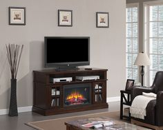 "The Dakota media mantel features an Arts & Crafts styling with tempered glass windowpane doors, antique brass hardware and open, partitioned center shelf. This multi-function media mantel surrounds a 26"" ClassicFlame electric fireplace insert."