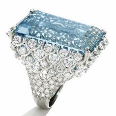 Aquamarine & dripping in diamonds.