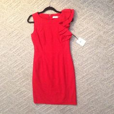 NWT Calvin Klein statement red dress Brand new elegant red dress never worn with ruffle on left arm sleeve. It's in perfect condition and would love to wear it, it's just a little too big but would fit any size 4! Will take offers! Calvin Klein Dresses