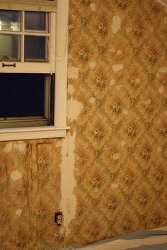 Past glory: water stained and damaged vintage wallpaper in a 1939 home.
