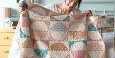 Vivid Fabrics Will be Striking in This Quilt, Too! Combine white fabric with your favorite fabric line to create this retro inspired quilt. It will be lovely to display during spring and summer, and will add a touch of warm to your decor during cool weather months. The quilt, from Tilda's World, is made entirely …