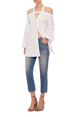 Rendered in a cotton shirting, this **Ellery** top features an off-the-shoulder design with V shape shoulder straps, long balloon sleeves, and a short shift silhouette.