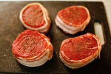 Bacon-Wrapped Filet Mignon Recipe: Filet Mignon Steaks Wrapped with Strips of Bacon and Pan-Fried in Butter