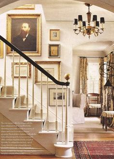 Art work up the stairs in an elegant foyer and stairway - looks much more put together than the standard photographs up the stairs!