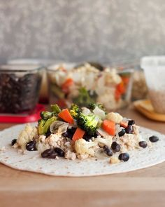 Make-Ahead Roasted Vegetable Burritos with Black Beans and Rice by the kitchn: Healthy make-ahead lunch! #Burrito #Veggie #Healthy #Make_Ahead