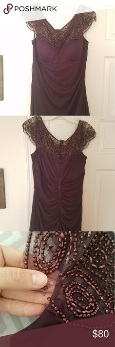 Cap sleeve beaded illusion bridesmaid or MOB dress Beautiful long and figure flattering, wine colored bridesmaid/mother-of-the-bride/prom dress  $80  Retails for $229 (see details in link)  Size 16 Color wine  http://www.davidsbridal.com/Product_cap-sleeve-beaded-illusion-neckline-dress-xs4843_long-bridesmaid-dresses  Worn once as a bridesmaid dress. Small tear on sleeve (shown in picture). Tear can be easily fixed and size can be altered.  Make me an offer! David's Bridal Dresses Wedding