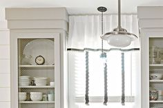 Bridge the gap between ceiling and upper cabinets with a handsome molding treatment. This built-up cornice is easy to DIY using paintable clear pine or poplar 1x6 boards.Shown: Primed pine board, about $1.50 per foot; lowes.com