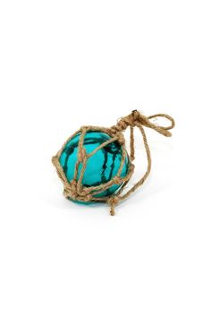 "This glass float will add a touch of nautical charm to your home. Hand-tied rustic jute cradles this replica of the sought-after but difficult-to-find vintage Japanese glass floats. Beautiful blue color fits in with almost any home decor. Ready to hang or rest on a shelf or in a bowl filled with other treasures from the sea.    Dimensions: 9""   Small Glass Float by Fiddleheads Home & Garden. Home & Gifts - Home Decor - Decorative Objects Washington"