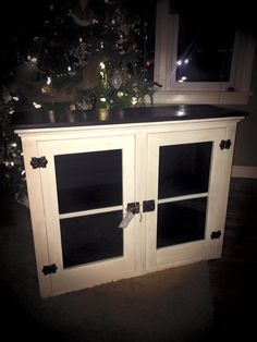 Side board cabinet redone in Old white.