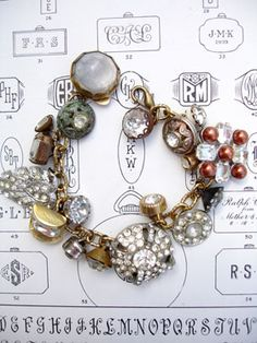 Vintage Rhinestone Button Bracelet Number 36 This bracelet has all vintage rhinestone buttons. There are so many different varieties and sizes, some with lacy bezels, some with clean setting and no prongs, some with gold tone settings, most with silver, all with various signs of age (which we love!)!...